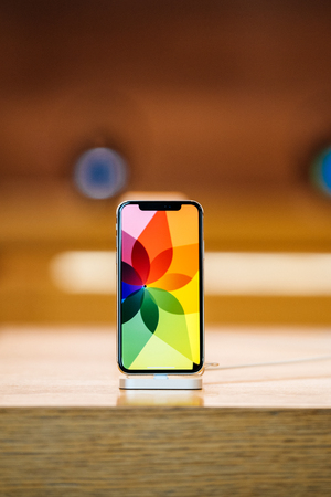 STRASBOURG, FRANCE - NOV 3, 2017: Latest Apple iPhone X goes on sale in Apple Store worldwide - super retina OLED display with demonstration effects