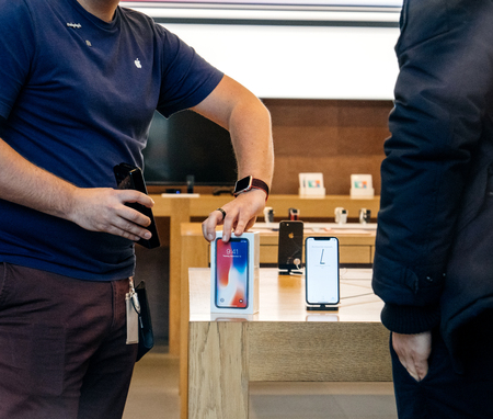 STRASBOURG, FRANCE - NOV 3, 2017: Apple Genius selling the latest Apple iPhone X to first customers in France at Apple Store