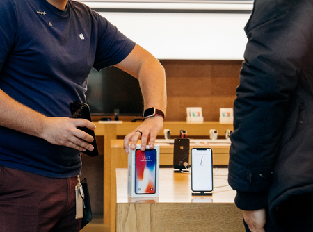 STRASBOURG, FRANCE - NOV 3, 2017: Apple Genius selling the new Apple iPhone X to first customers in France at Apple Store