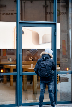 STRASBOURG, FRANCE - NOV 3, 2017: Latest Apple iPhone X goes on sale in Apple Store worldwide - people customers admiring from street the device Editorial