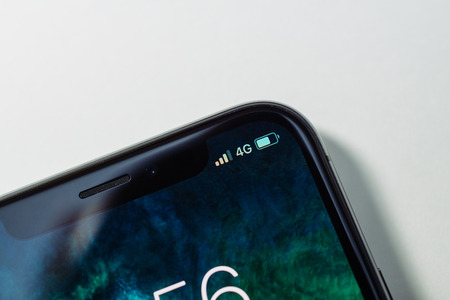 PARIS, FRANCE - NOV 3, 2017: 4G LTE icon in the corner of the new OLED Apple iPhone X 10  from Apple Computers Editorial