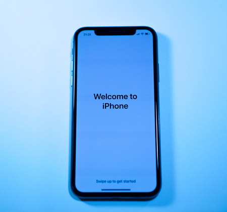 PARIS, FRANCE - NOV 3, 2017: Welcome to Apple iPhone X 10 message on the latest smartphone from Apple Computers