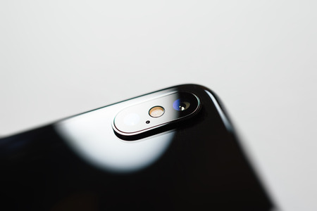 PARIS, FRANCE - NOV 3, 2017: Rear view dual camera on the new Apple iPhone X 10  from Apple Computers