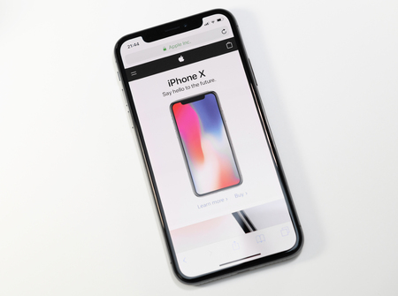 PARIS, FRANCE - NOV 3, 2017: New Apple iPhone X 10 smartphone with Apple Store website on the OLED Super Retina Display Editorial