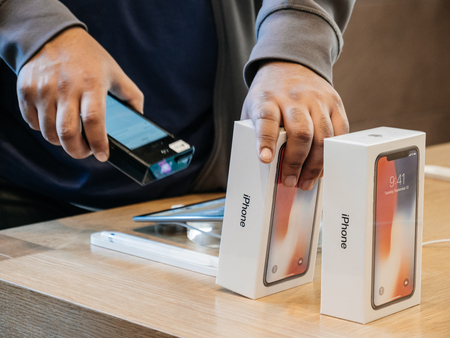 STRASBOURG, FRANCE - NOV 3, 2017: Seller scanning barcode of the latest iPhone X 10 smartphone before purchase at Apple Store Computers Editorial
