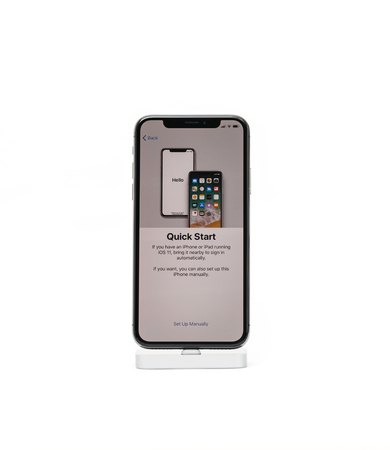 PARIS, FRANCE - NOV 5, 2017: New Apple iPhone X 10 smartphone isolated white background Quick start option on the new phone