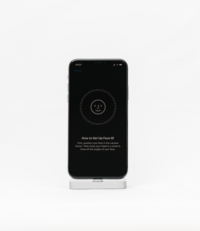 PARIS, FRANCE - NOV 5, 2017: New Apple iPhone X 10 smartphone isolated white background how to set up face ID