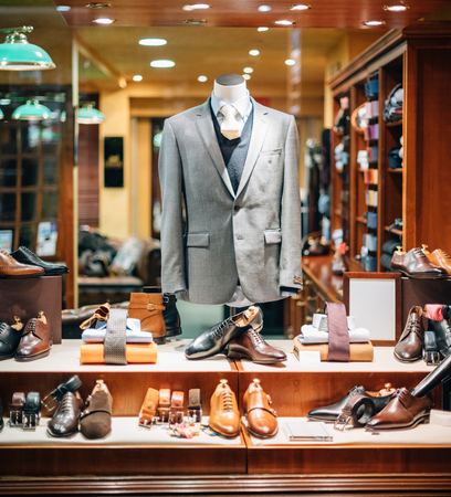 Business shirt, belt, suit,blazer, shoes,ties at male tailoring on tailor shop mannequin in male fashion store showcase window