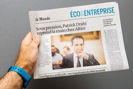 PARIS, FRANCE - NOV 19, 2017: Man pov at the Patrick Drahi, CEO of Altice and SFR in the economical review press of Le Monde newspaper