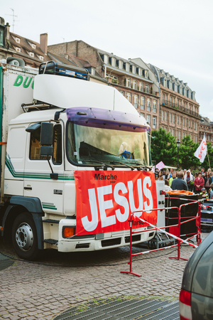 STRASBOURG, FRANCE - MAY 30, 2015: Trucks with Jesus banner at the March for Jesus the annual interdenominational event in which Christians march through towns and cities with flags and pray