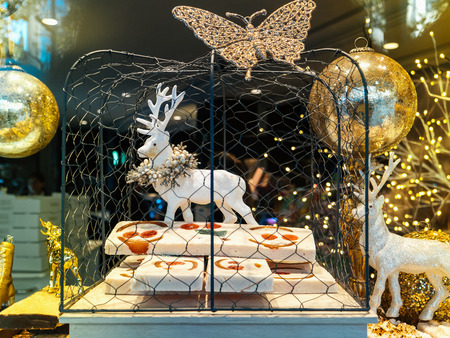 beautiful traditional christmas decorations of spanish bakery selling tartes and cakes with diverse figurines of reindeers