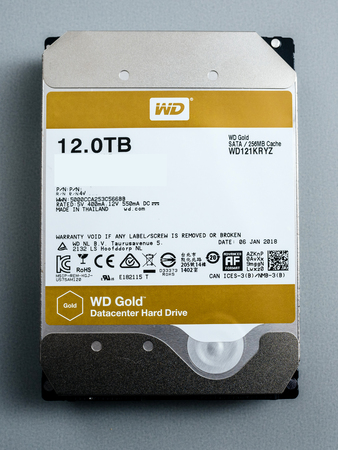 PARIS, FRANCE - FEB 15, 2018: Front view of new Western Digital Gold HDD enterprise level 12 terabytes disk drive