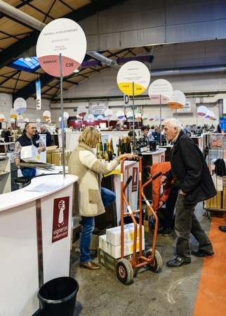 STRASBOURG, FRANCE - FEB 19, 2018: Customers loading to transport buying French wine at the Vignerons independant English: Independent winemakers of France wine fair in Strasbourg Editoriali