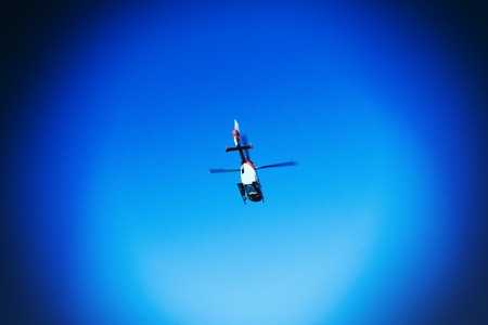 BADEN WURTTEMBERG, GERMANY - FEB 25, 2018: rescue helicopter from DRF Luftrettung German foundation flying in clear blue sky powerful vignette Редакционное
