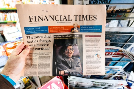 PARIS, FRANCE - MAR 15, 2018: International newspaper Financial Times  with portrait of Stephen Hawking the English theoretical physicist, cosmologist dead on 14 March 2018