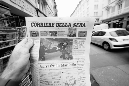 PARIS, FRANCE - MAR 15, 2018: Italian Corriere della Sera newspaper with portrait of Stephen Hawking the English theoretical physicist, cosmologist dead on 14 March 2018 outdoor press kiosk - black and white,