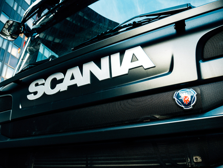 STRASBOURG, FRANCE - MAR 5, 2018: Side view of Scania logotype insignia logo on the front part of the radiator of a powerful G410 truck new Swedish truck