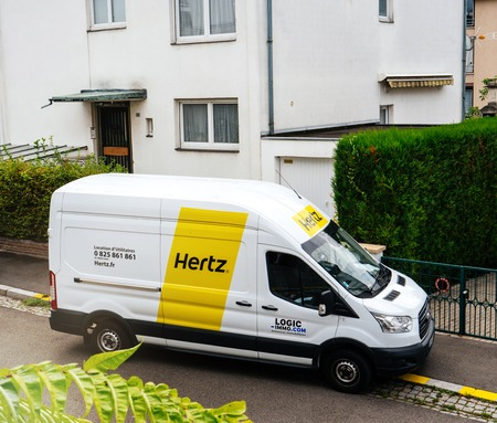PARIS, FRANCE - SEP 13, 2017: White HERTZ rent a van service seen from above on a French street near a house