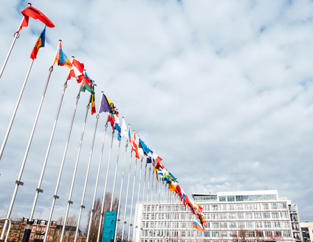 STRASBOURG, FRANCE - MAR 29, 2018: View from below of Flag of Russia flying half-mast at Council of Europe as a tribute and mourning of victims of fire at Zimnyaya Vishnya shopping centre Kemerovo Editorial