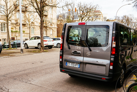 STRASBOURG, FRANCE - CIRCA 2018: Rear view of new Opel Vivaro BiTurbo passenger minivan car parked on a French street Editorial