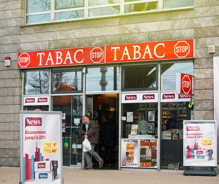 KEHL, GERMANY - MAR 29, 2018: Border shopping - man exit German taback shop offering cheaper than in France cigarettes and tobacco in city of Kehl, Germany 4 km from France 에디토리얼