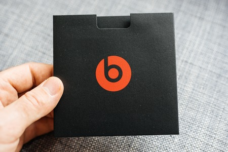 PARIS, FRANCE - MAR 31, 2018: Man unboxing new Apple Beats By Dr Dre Beats Studio 3 Wireless headphones with Pure Adaptive Noise Canceling Pure ANC - instruction manual box