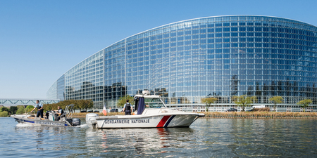 STRASBOURG, FRANCE - APR 17, 2018: National Gendarmerie boat near European Parliament facade during Emmanuel Macron, visit in a bid to shore up support for his ambitious plans for post-Brexit reforms of EU