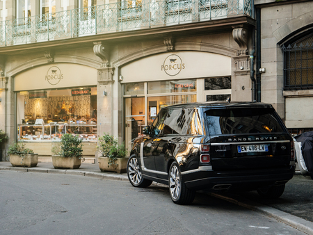 STRASBOURG, FRANCE - 13 MAR, 2018: New Range Rover Land Rover Vogue, the luxury British SUV parked in central French street near butcher shop Porcus (Place du Temple Neuf) Editorial