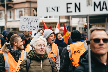 STRASBOURG, FRANCE  - MAR 22, 2018: People with placards at demonstration protest against Macron French government string of reforms, mutiple trade unions called public workers to strike