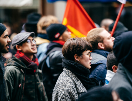 STRASBOURG, FRANCE  - MAR 22, 2018: French woman at demonstration protest against Macron French government string of reforms, mutiple trade unions called public workers to strike Éditoriale
