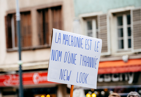 STRASBOURG, FRANCE  - MAR 22, 2018: La Macronie est le nom dun tyrannie new look - Macronie is the name of a tyranny new look on placard in in France at protest against Macron Editorial