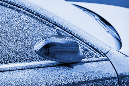 Beautiful car covered with snow - Topaz Brown Metallic color Blue color toned chromacity
