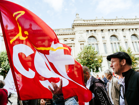 STRASBOURG, FRANCE - SEP 12, 2018: Man with CGT flag during a French Nationwide day of protest against labor reform proposed by Emmanuel Macron Government