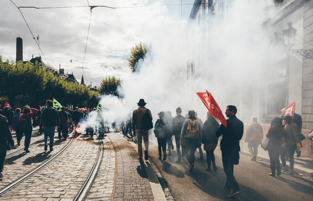STRASBOURG, FRANCE - SEP 12, 2018: Big Smoke grenade thrown by people during French Nationwide day of protest against labor reform proposed by Emmanuel Macron Government Redakční
