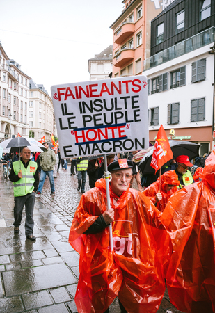 STRASBOURG, FRANCE - SEP 12, 2018: Shame Macron placard in male hand during a French Nationwide day of protest against labor reform proposed by Emmanuel Macron Government