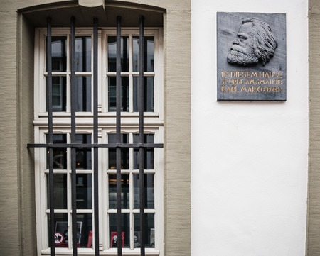 TRIER, GERMANY - FEB 21, 2015: Front view of commemorative plaque on the facade of the house were Karl Marx, the German philosopher, economist, sociologist, journalist, and revolutionary socialist was born in 1818