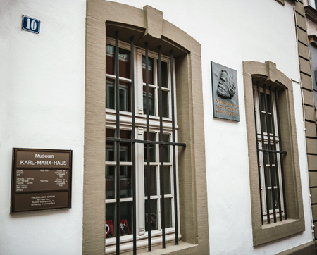 TRIER, GERMANY - FEB 21, 2015: Side view of commemorative plaque on the facade of the house were Karl Marx, the German philosopher, economist, sociologist, journalist, and revolutionary socialist was born