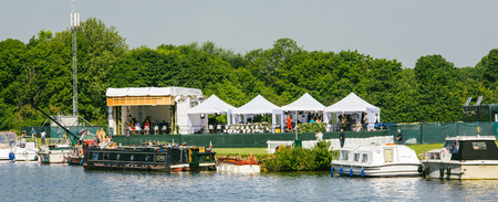 WINDSOR, BERKSHIRE, UNITED KINGDOM - MAY 19, 2018: Media TV stations tents near Tamisa river reporting live to cover the royal wedding marriage celebration of Prince Harry, Duke and Meghan Markle - vivid colors