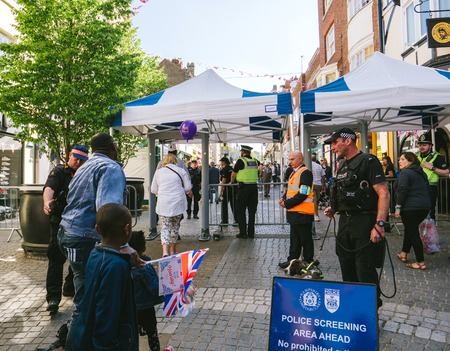 WINDSOR, BERKSHIRE, UNITED KINGDOM - MAY 19, 2018: Police screening area ahead for the royal wedding marriage celebration of Prince Harry, Duke of Sussex and the Duchess of Sussex Meghan Markle