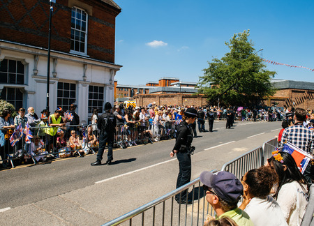 WINDSOR, BERKSHIRE, UNITED KINGDOM - MAY 19, 2018: Street atmosphere at royal wedding marriage celebration of Prince Harry, Duke of Sussex and the Duchess of Sussex Meghan Markle