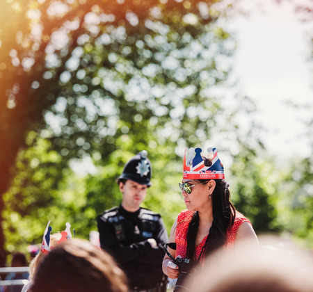 WINDSOR, BERKSHIRE, UNITED KINGDOM - MAY 19, 2018: Woman with crown at the royal wedding marriage celebration of Prince Harry, Duke of Sussex and the Duchess of Sussex Meghan Markle