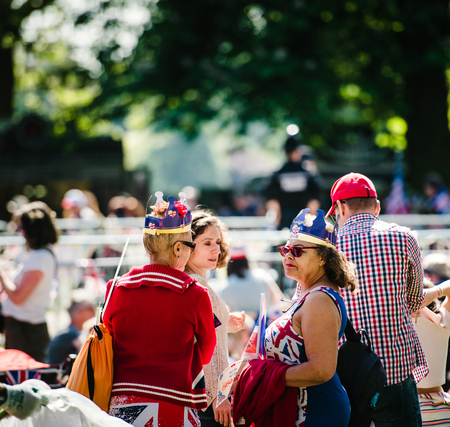 WINDSOR, BERKSHIRE, UNITED KINGDOM - MAY 19, 2018: Female friends at royal wedding marriage celebration of Prince Harry, Duke of Sussex and the Duchess of Sussex Meghan Markle