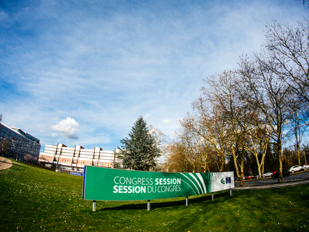STRASBOURG, FRANCE - APR 6, 2018: Congress session signage displayed in front of the Council of Europe building on a serene springtime background. The sessions are held twice a year by the Congress of Local and Regional Authorities in the headquarters of  報道画像