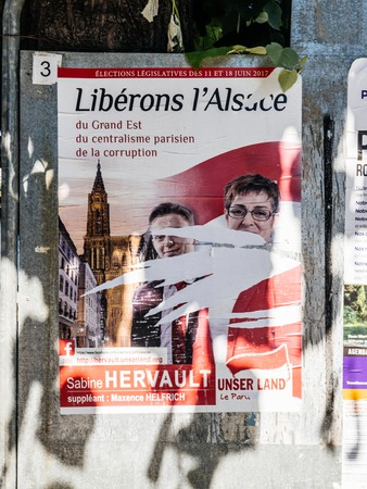 STRASBOURG, FRANCE - JUN 10, 2017: Political posters advertising of Elections legislatives francaises de 2017 French legislative election of UNser Land party Editorial