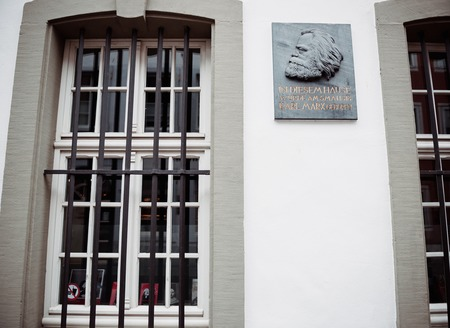 TRIER, GERMANY - FEB 21, 2015: Front view of commemorative plaque on the facade of the house were Karl Marx in Trier, Germany