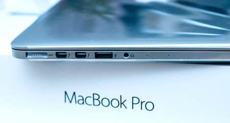 LONDON, UNITED KINGDOM - JAN 14, 2015: Unboxing of the new Apple MacBook Pro laptop computer with fast processors and GPU with Thunderbolt and MagSafe, USB 3