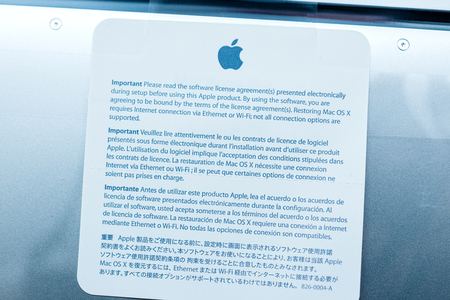 LONDON, UNITED KINGDOM - JAN 14, 2015: Software license agreement of the new Apple MacBook Pro laptop computer with fast processors and GPU unboxing