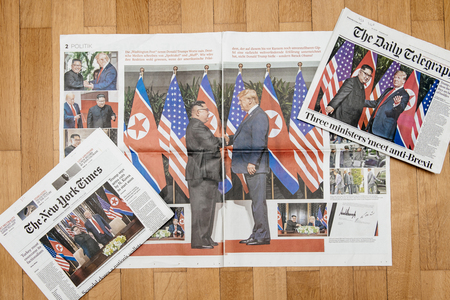 PARIS, FRANCE - JUNE 13, 2018: Multiple International newspapers with cover U.S. President Donald Trump meeting North Korean leader Kim Jong-un in Singapore Editorial