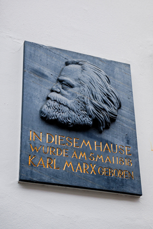 TRIER, GERMANY - FEB 21, 2015: Detail of commemorative plaque on the facade of the house were Karl Marx, the German philosopher, economist, sociologist, journalist, and revolutionary socialist was born in 1818