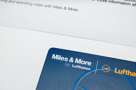 FRANKFURT, GERMANY - JAN 14, 2015: Close-up macro detail of Miles and More card received by post from German Lufthansa airlines Member Club